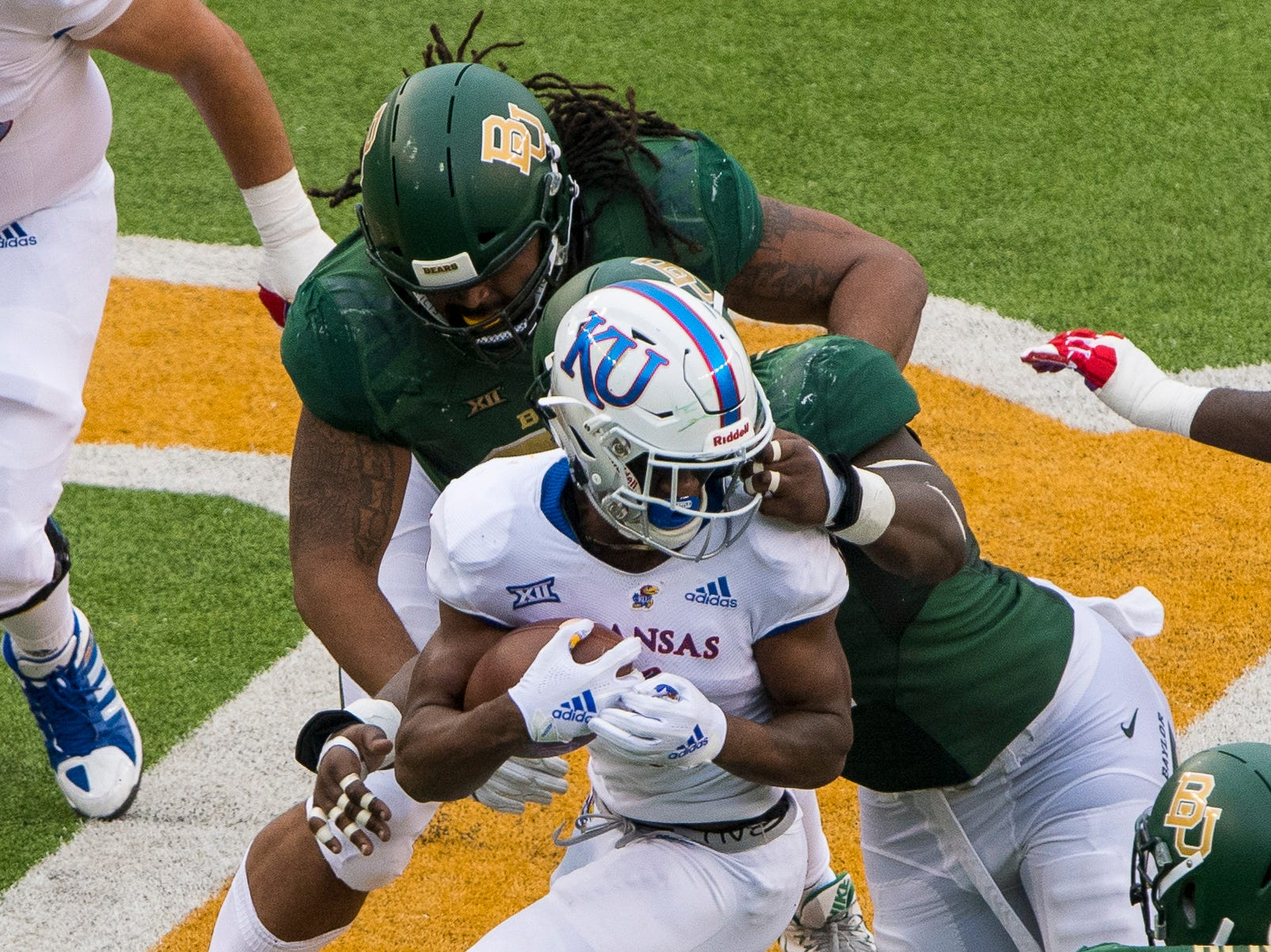 The Baylor Bears defense is called for a face-mask penalty on Kansas Jayhawks running back Pooka Williams Jr. (1) during the second half at McLane Stadium.
