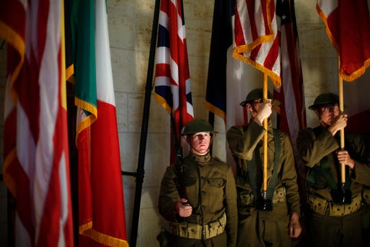 Men wearing World War I military uniforms attend a remembrance ceremony in the Meuse-Argonne cemetery in northeastern France on Sept. 23, 2018. Sunday marks the 100th anniversary of the end of World War I.