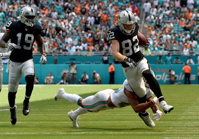 Miami Dolphins defensive back Minkah Fitzpatrick tackles Oakland Raiders wide receiver Jordy Nelson during the first half at Hard Rock Stadium.