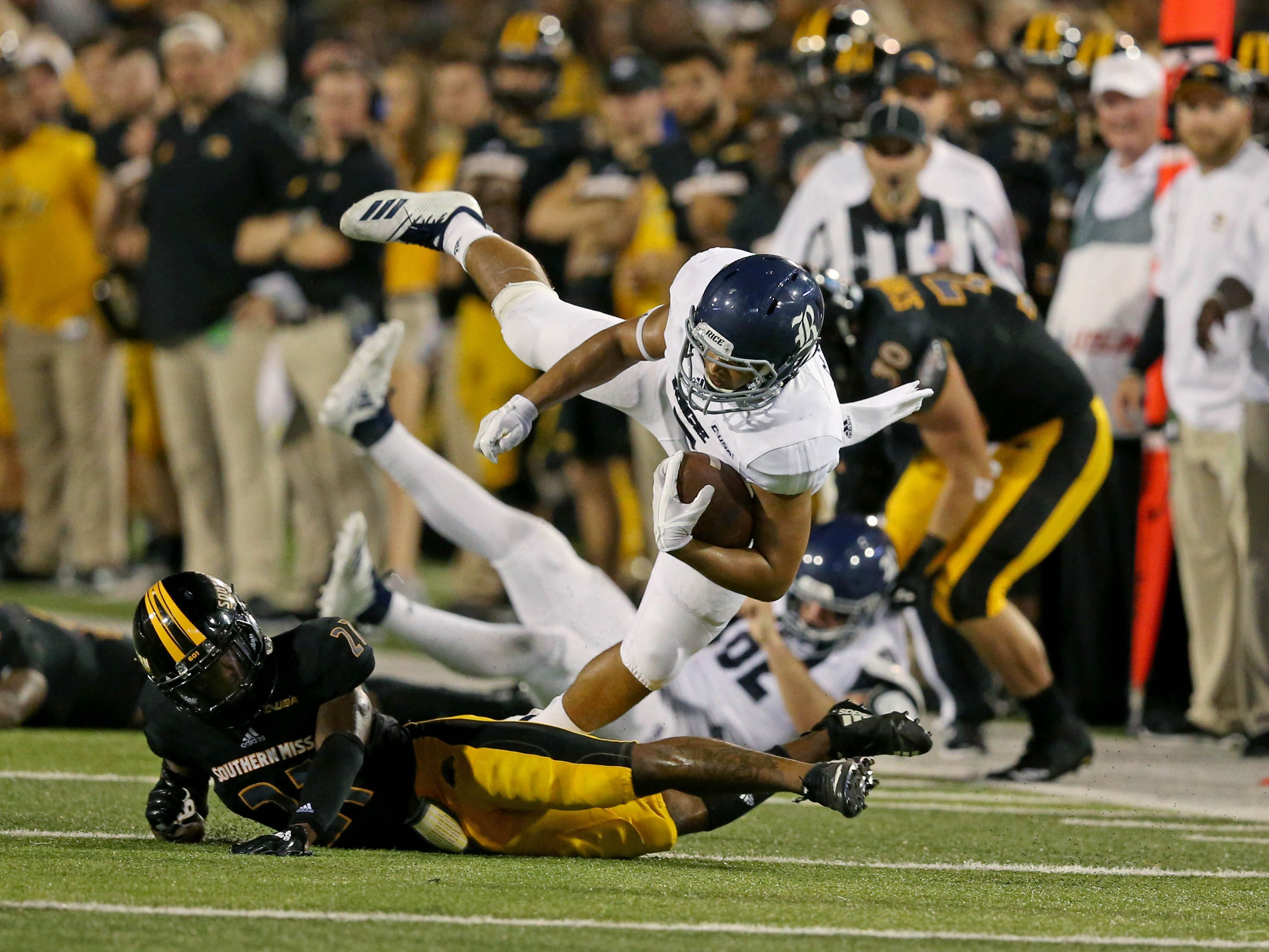 Rice Owls tight end Jordan Myers (7) is tackled by Southern Miss Golden Eagles defensive back Rachuan Mitchell (21) in the second half at M. M. Roberts Stadium.