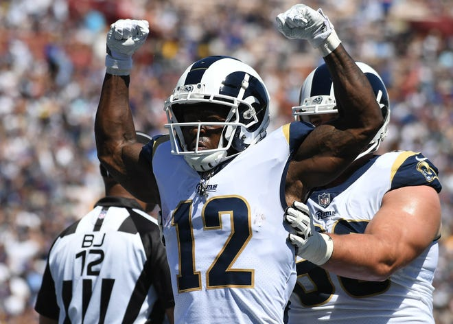 Sep 23, 2018; Los Angeles, CA, USA; Los Angeles Rams wide receiver Brandin Cooks (12) celebrates a touchdown against the Los Angeles Chargers in the first half at Los Angeles Memorial Coliseum. Mandatory Credit: Richard Mackson-USA TODAY Sports