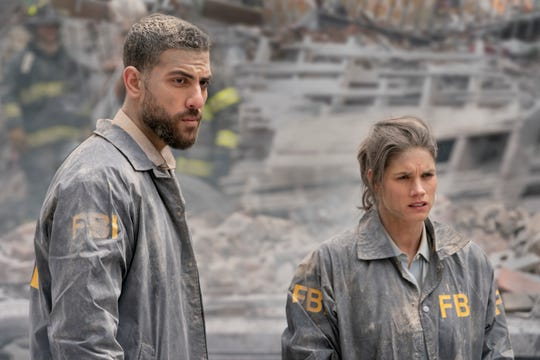 Special Agent Maggie Bell (Missy Peregrym), right, and her partner,  Special Agent Omar Adom 'OA' Zidan (Zeeko Zaki), are covered in ash after barely escaping death during an apartment building explosion in the series premiere of CBS's 'FBI.'