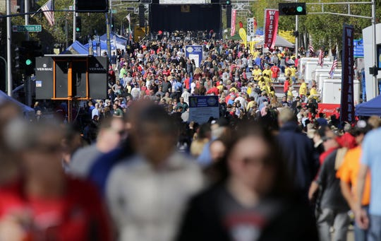 An early crowd fills College Avenue at Octoberfest on September 30, 2017.