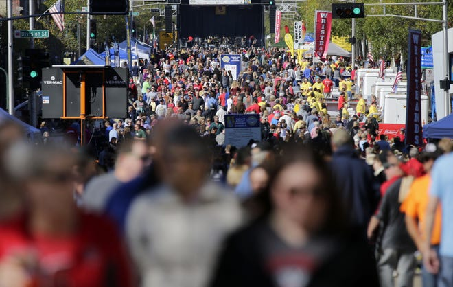 A huge crowd fills College Avenue at last year's Octoberfest. Crowds are again expected to gather in downtown Appleton for the annual event this weekend.
