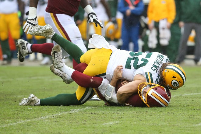 Green Bay linebacker Clay Matthews sacks Washington quarterback Alex Smith in the third quarter of Sunday's game at FedEx Field. Matthews was called for a penalty on the play.
