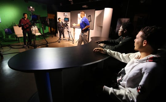 TV Production teacher Mario Cuniglio instructs students in the TV studio at Lakewood High.