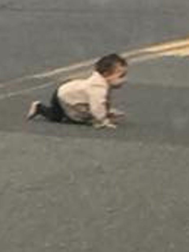 Lakewood: Baby crawls across street in traffic in