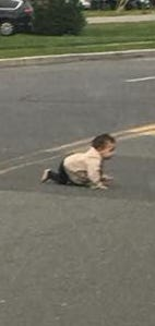 A baby is shown crawling across Joe Parker Road in Lakewood.