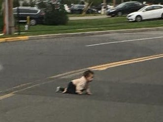 Photo shows baby crawling across New Jersey street; child unharmed