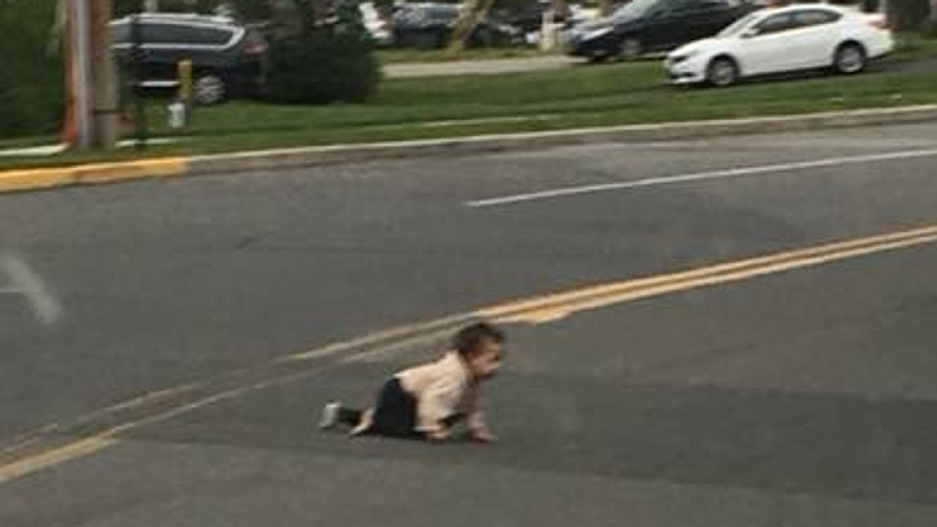 Lakewood: Baby crawls across street in traffic in