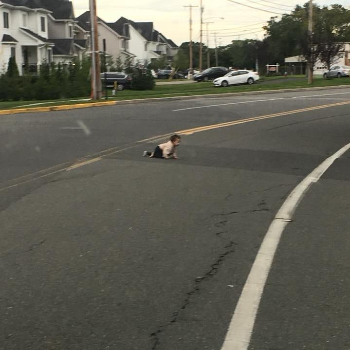 Lakewood: Baby crawls across street in traffic in controversial viral photo