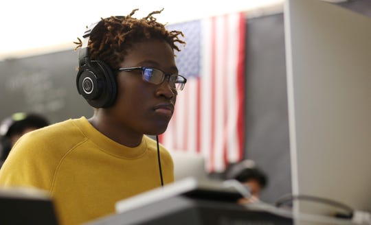 Paris Mears, 17, a senior, works on her album in the Recording Arts class