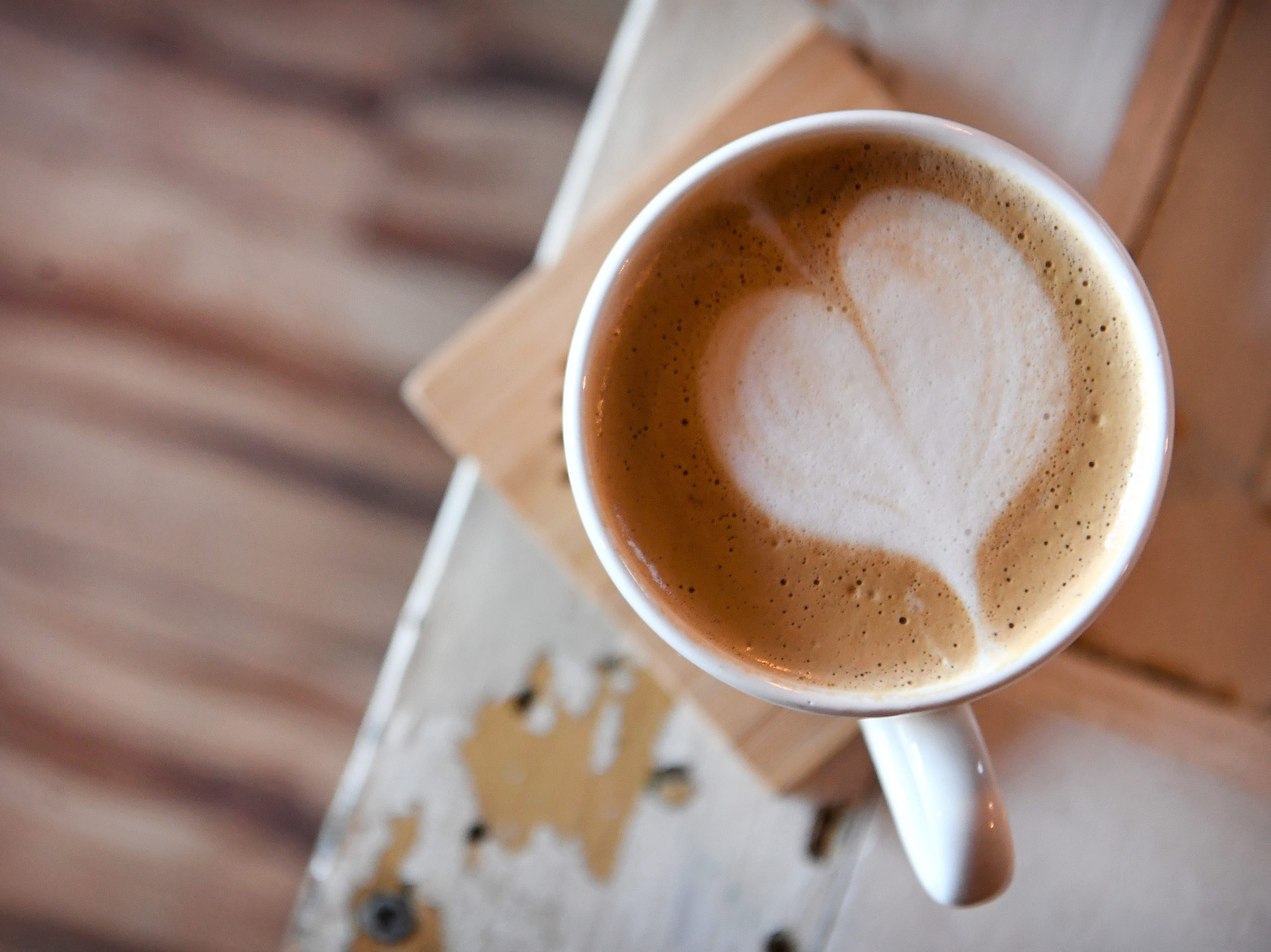 A heart adorns the top of a latte at the Beehive Coffee Bar in Arden.