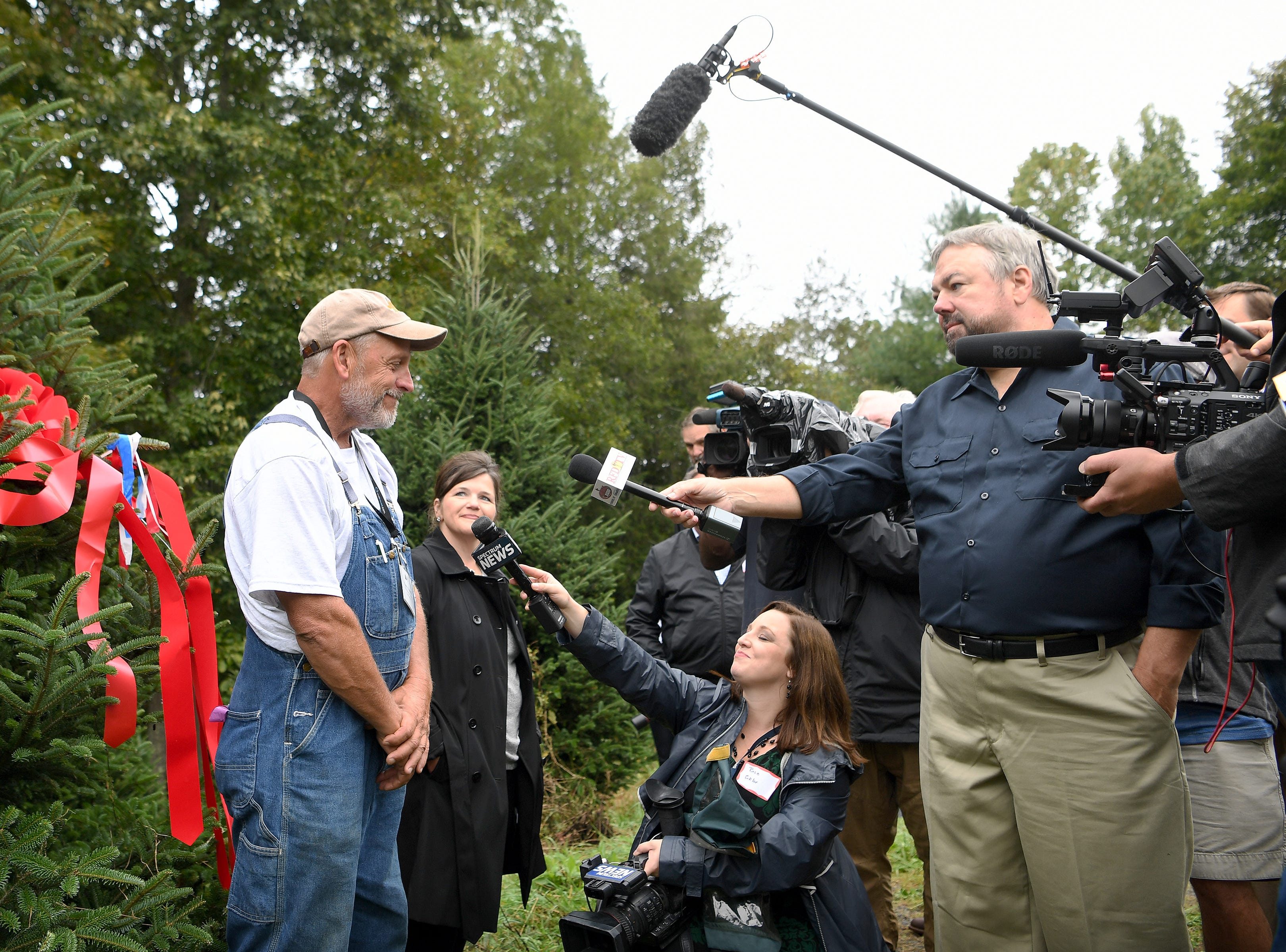 "Avery County Christmas tree grower Larry Smith is interviewed by members of the media after White House officials picked which one of his trees will be displayed in the Blue Room this Christmas season during an event at his Newland farm on Sept. 24, 2018. ""It's sorta like winning the Super Bowl,"" Smith said. ""To represent the whole real Christmas tree industry is a real honor."""