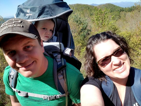 John and Amy Saunders, of Waynesville, balance their work-at-home lives with a little one in tow.