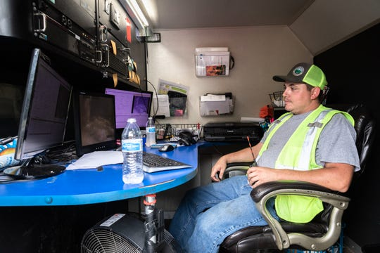 Mitchell Metcalf, a CCTV camera operator with Buncombe County's Metropolitan Sewage District, monitors a sanitary sewer on McDowell Street Sept. 24, 2018, after a sewage spill Friday.