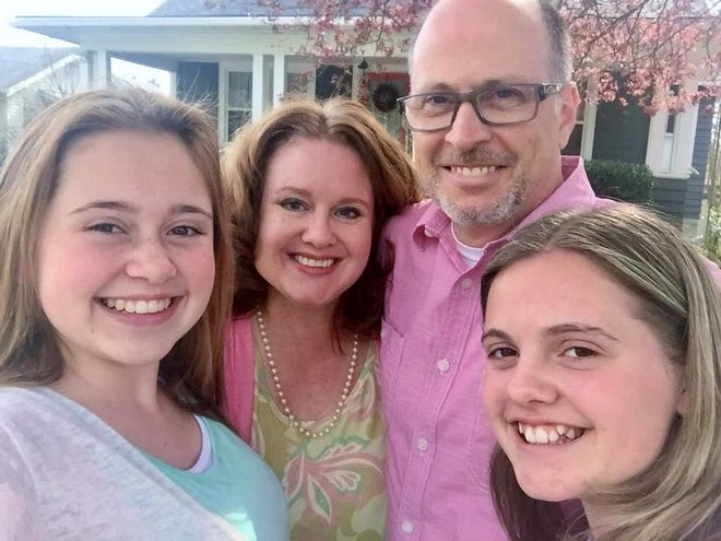 Angela and Eddie Roberts, of Hendersonville, along with daughters Emma and Anna. Working from home has gotten easier as the girls became more self-sufficient.