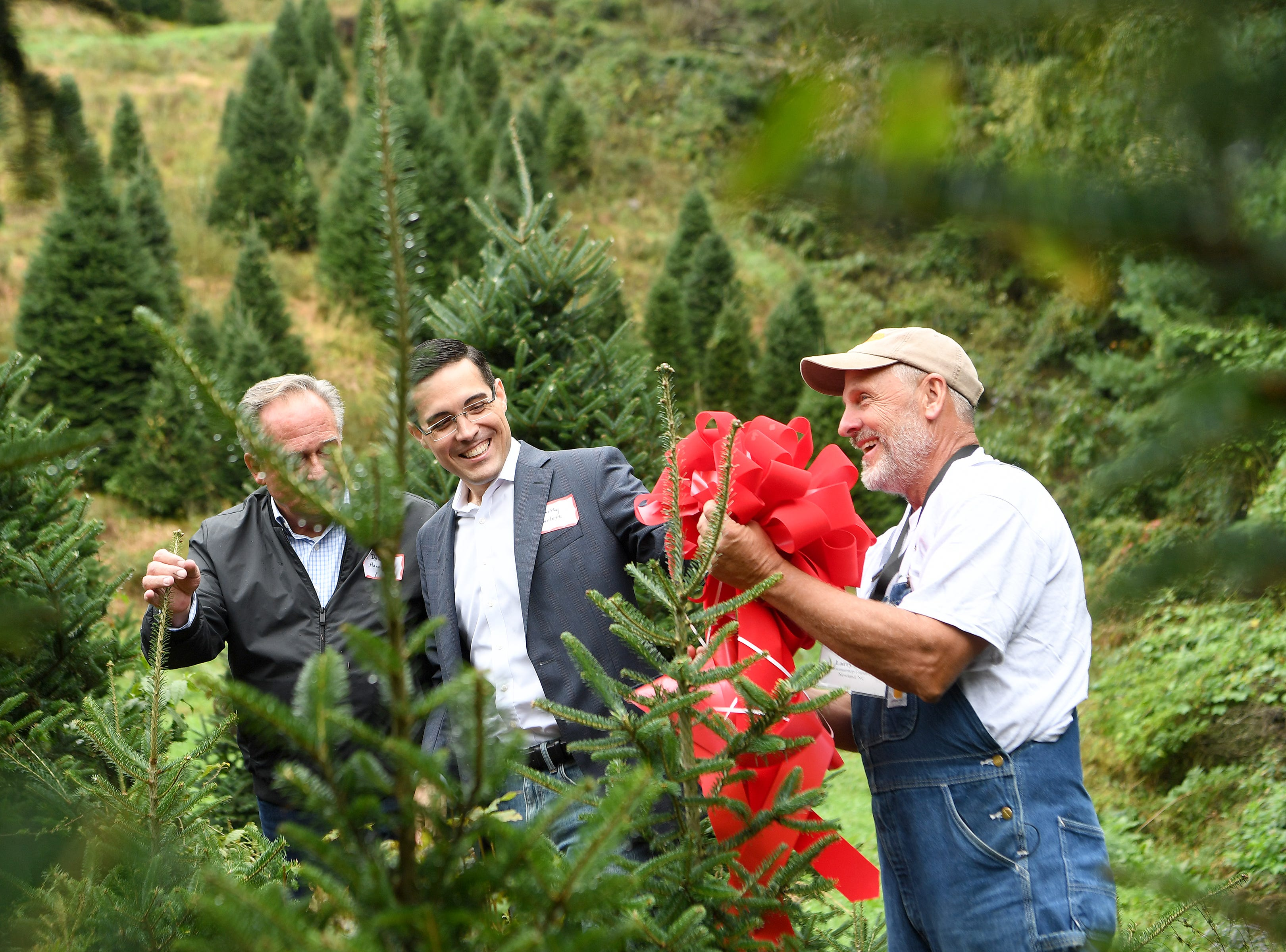 White House superintendent of grounds Dale Haney, left, and chief usher Timothy Harleth, center, decide on which of 
