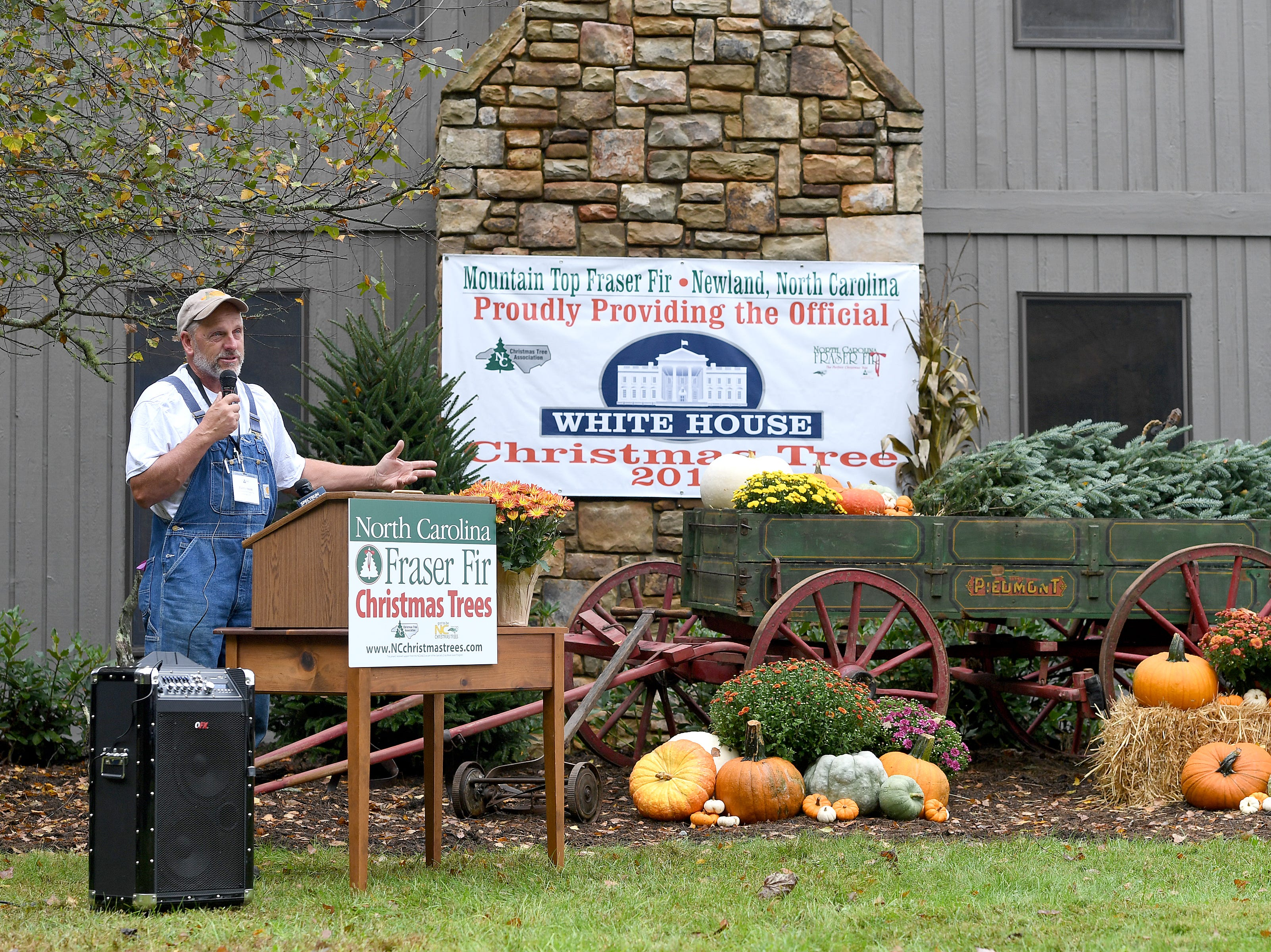 Avery County Christmas tree grower Larry Smith addresses the crowd during an event at his farm in Newland on Sept. 24, 2018. Smith was named the Grand Champion in the National Christmas Tree Association's Christmas tree contest and with the title comes the honor of providing a tree to the White House to be displayed in the Blue Room during the Christmas season.