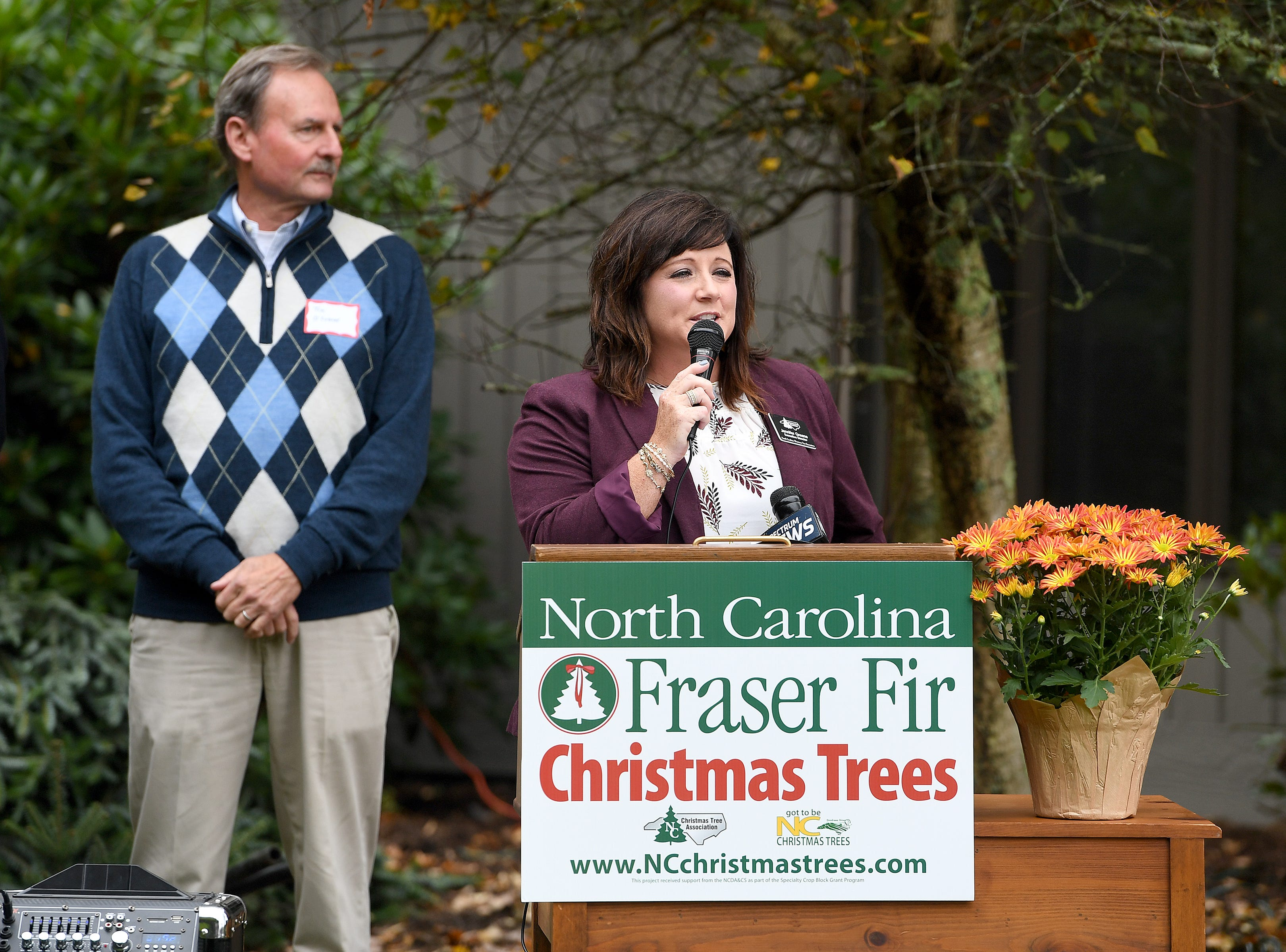 Jennifer Greene, executive director of the North Carolina Christmas Tree Association, addresses the crowd during an event at Mountain Top Fraser Fir in Newland on Sept. 24, 2018. Larry Smith, owner of the farm, was named the Grand Champion in the National Christmas Tree Association's Christmas tree contest and with the title comes the honor of providing a tree to the White House to be displayed in the Blue Room during the Christmas season.