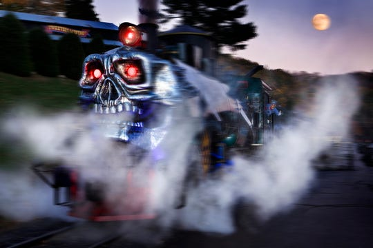 Tweetsie Railroad's annual Ghost Train rolls down Main Street in October.