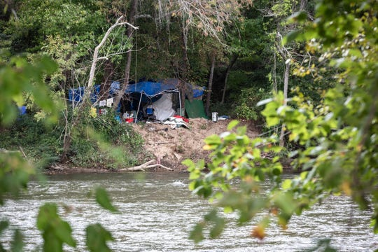 A homeless camp on the French Broad River across from Lyman Street in the River Arts District.