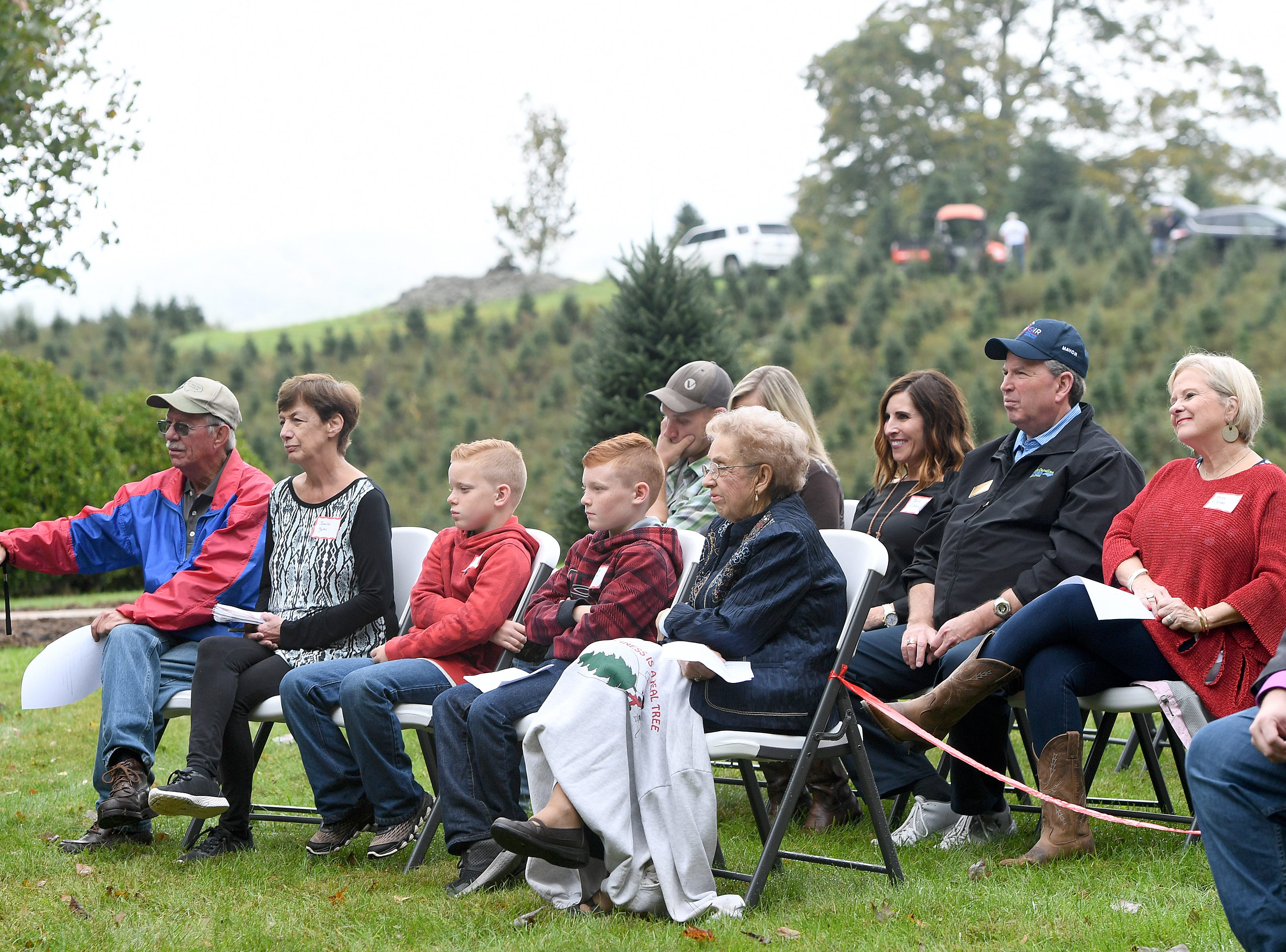 Family and friends attend an event at Mountain Top Fraser Fir in Newland on Sept. 24, 2018. Larry Smith, owner of the farm, was named the Grand Champion in the National Christmas Tree Association's Christmas tree contest and with the title comes the honor of providing a tree to the White House to be displayed in the Blue Room during the Christmas season.