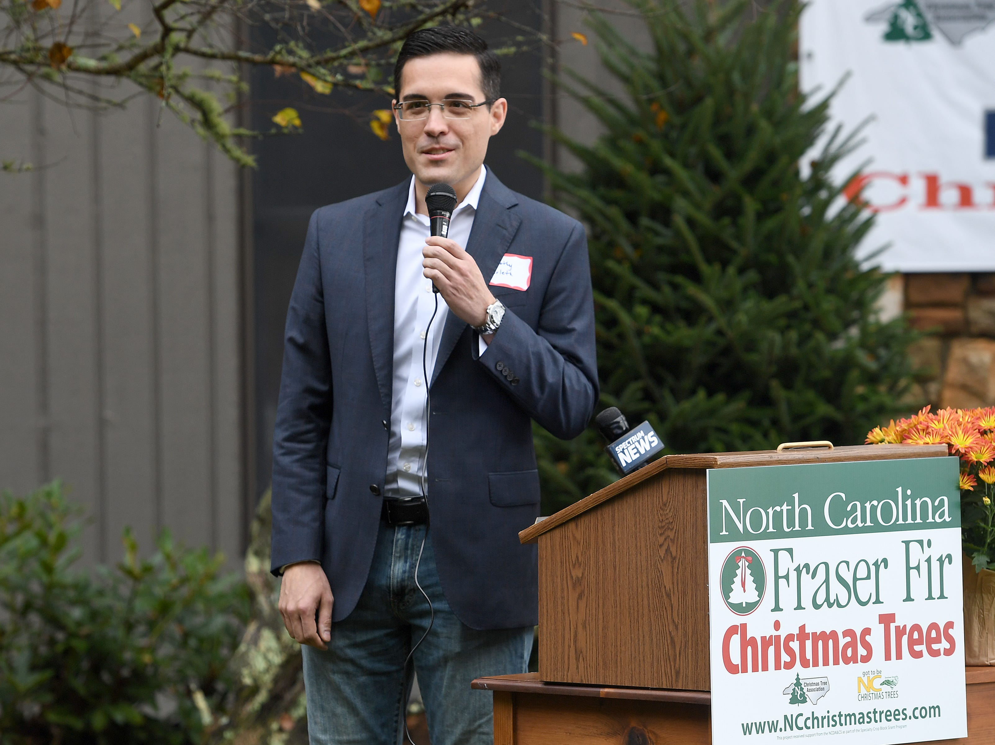 White House chief usher Timothy Harleth addresses the crowd during an event at Mountain Top Fraser Fir in Newland on Sept. 24, 2018. Larry Smith, owner of the farm, was named the Grand Champion in the National Christmas Tree Association's Christmas tree contest and with the title comes the honor of providing a tree to the White House to be displayed in the Blue Room during the Christmas season.