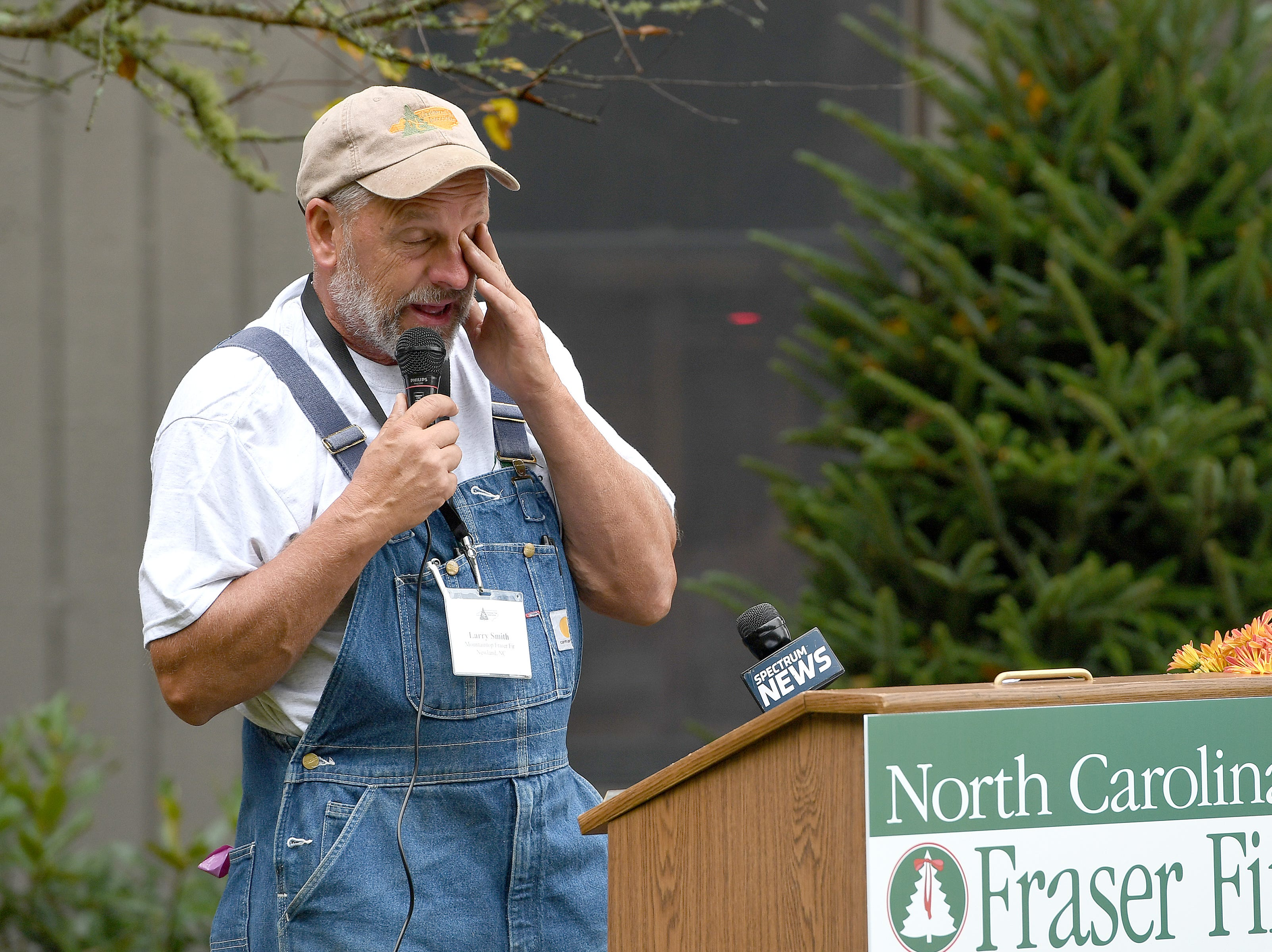 Avery County Christmas tree grower Larry Smith becomes emotional as he addresses the crowd during an event at his farm in Newland on Sept. 24, 2018. Smith was named the Grand Champion in the National Christmas Tree Association's Christmas tree contest and with the title comes the honor of providing a tree to the White House to be displayed in the Blue Room during the Christmas season.