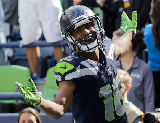 Seahawks wide receiver Tyler Lockett celebrates after scoring a first-half touchdown.