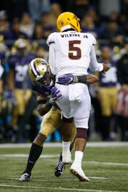 Washington Huskies defensive back Jordan Miller (23) hits Arizona State Sun Devils quarterback Manny Wilkins (5) during the second quarter at Husky Stadium.