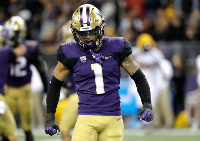 Washington defensive back Byron Murphy celebrates after Washington defensive back JoJo McIntosh intercepted a pass during Saturday's game against Arizona State.