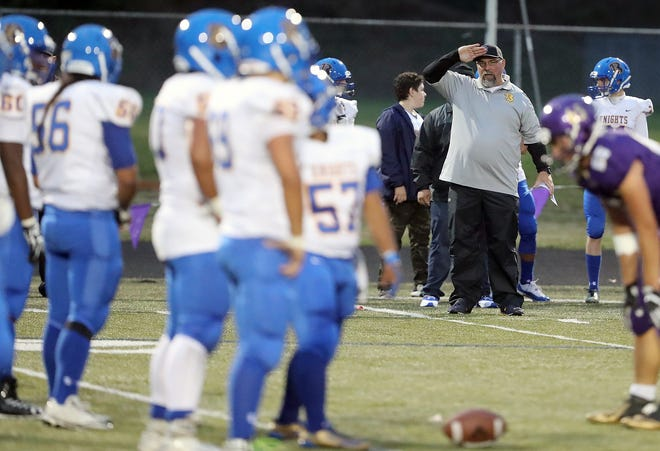Bremerton football coach Paul Theriault uses a hand signal to relay a play call to his offense during a game against North Kitsap in September.