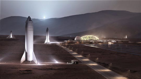 Several SpaceX Big Falcon Spaceships are seen on the surface of Mars in this rendering released by the company.