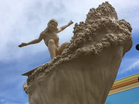 The tall sand sculpture in Cocoa Beach has been dedicated to Caroline Marks, the youngest-ever qualifier on the women's world tour.