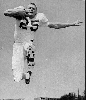 Tommy McDonald is shown in action in this 1956 file photo. McDonald, who played seven seasons with the Philadelphia Eagles, died on Monday. He was 84.