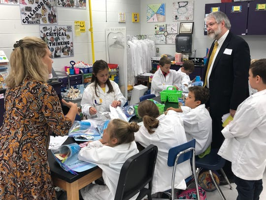 Unioto Elementary SCOPES teacher Jenni Domo tells State Superintendent of Public Education Paolo DeMaria about the project students are working on in which they are creating models of boats that could be used in a hurricane relief effort.