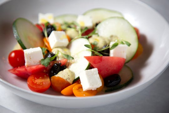 Tomato Salad with olives, feta, cucumber and peperoncini dressing at 20 Brix in Milford.