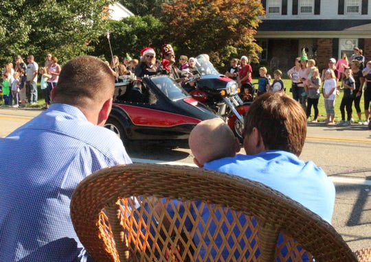 Brody Allen, 2, had a curbside seat with dad Todd and mom Shilo Allen at a Christmas parade in his honor Sunday.