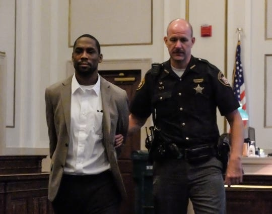 William Arnold is led into Judge Jermone Metz's courtroom Monday. He is charged with murder in the death of 16-year-old Hailey Hall.
