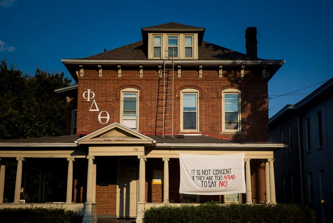 "A banner that reads, ""It is not consent if they are too afraid to say no"" hangs at the Phi Delta Theta fraternity house at Ohio University."