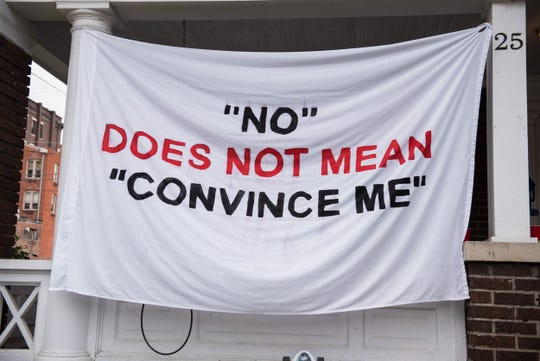 A banner protesting sexual assault hangs at the Alpha Epsilon Pi fraternity house at Ohio University in Athens.