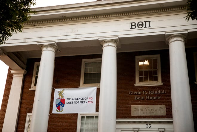 A banner protesting sexual assault hangs at the Beta Theta Pi fraternity house at Ohio University in this file photo. On Thursday, all fraternities were suspended due in part to seven new hazing allegations.