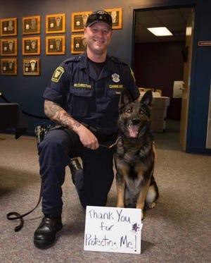 Cincinnati Police K-9 Otto and Officer Mark McChristian.