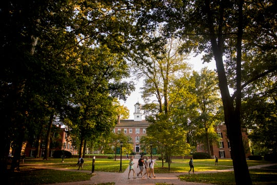 Students walk along the paths of College Green at Ohio University in Athens, Ohio Thursday, September 20, 2018. There have been a dozen reports of sexual assault at Ohio University since school started on August 27th.