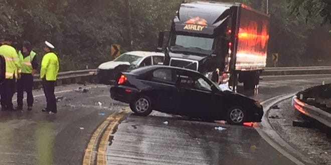 Police respond to the scene of a multiple vehicle fatal crash Monday morning on a curve in Hamilton-Cleves Road south of Hine Road.