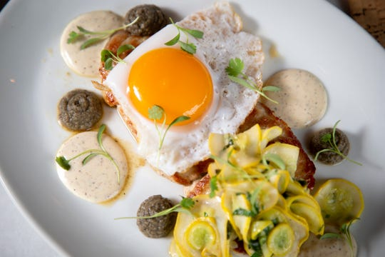 The Pork Flat Iron with ham brine, zucchini, summer squash, charred eggplant, carbonara mayo and a duck egg on top at 20 Brix in Milford.
