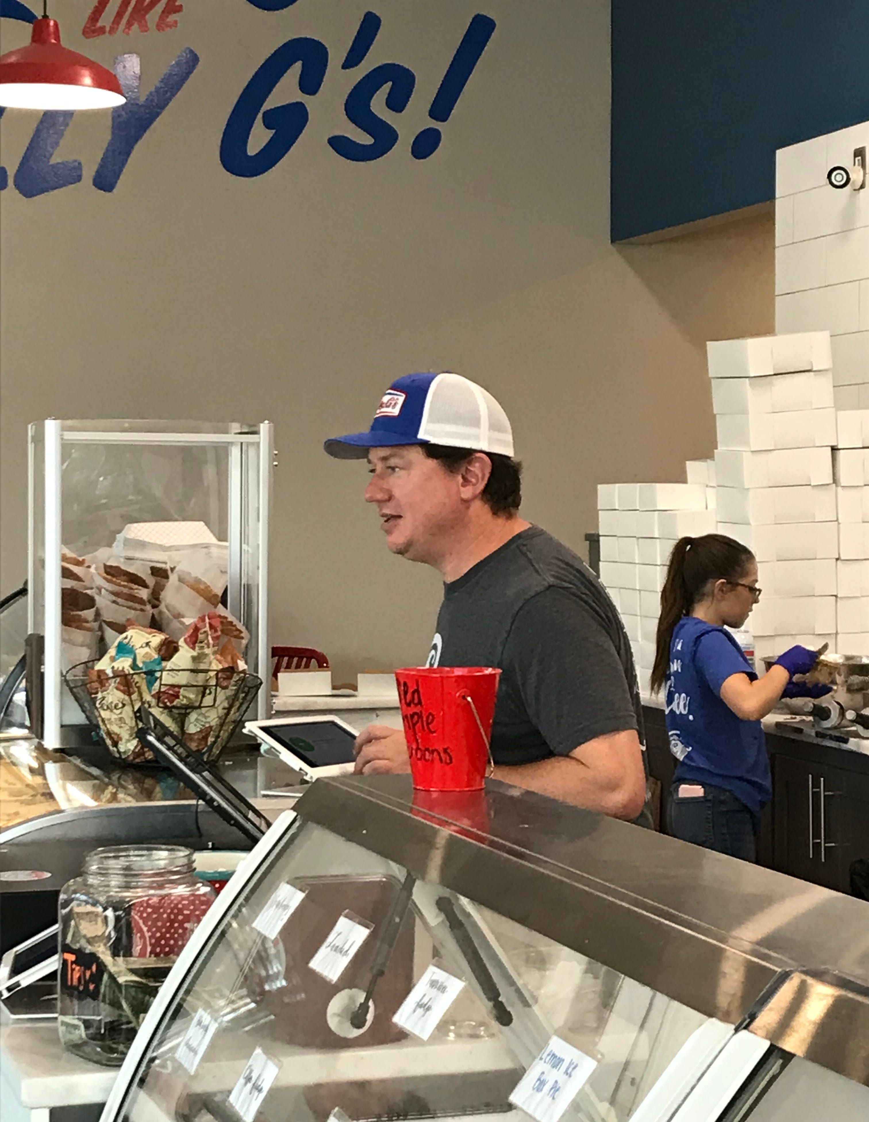 Owner Joey Boykin helps a customer at his Clarksville ice cream parlor, Golly G's Coffee, Ice Cream & Sweets.