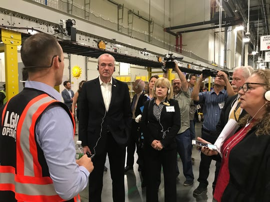 "Touting new jobs and innovative technology and sustainability methods, Gov. Phil Murphy toured the newest Amazon Edison Fulfillment Center Monday. Along with several other elected officials and community leaders, Murphy got a birds-eye view from the indoor catwalk of the 9,000 square foot facility before taking to the roof to check out the solar panel farm on top. The new center is the eighth Amazon facility in the state, since they first launched ""Operation New Jersey"" in 2012."