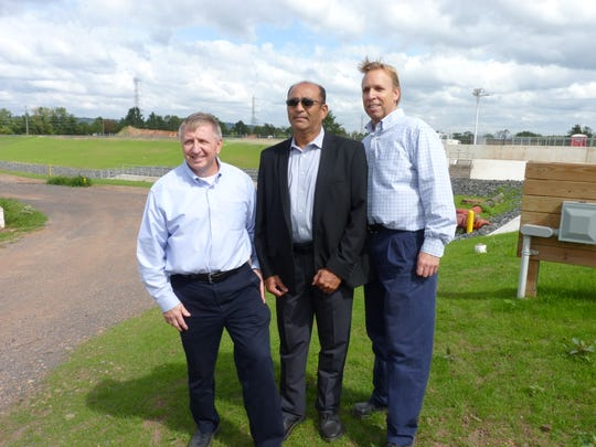 Oleg Kostin, left, Manoj Patel and Bill Walker of New Jersey American Water at the company's Raritan-Millstone Water Treatment Plant in Bridgewater after a new flood protection project was unveiled.